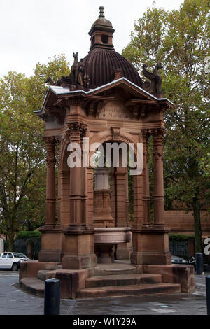 Sydney Australia, ornate 1884 baroque-inspired Victorian Gothic sandstone water fountain now a traffic roundabout - Stock Photo