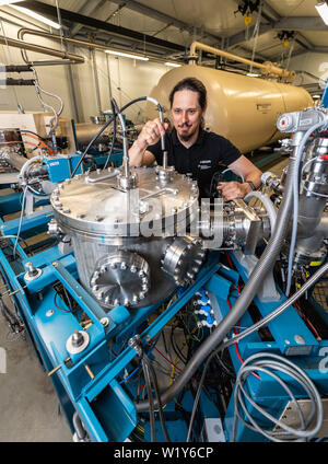 Dresden, Germany. 04th July, 2019. After the official commissioning of the rock cellar laboratory jointly built by Helmholtz-Zentrum Dresden-Rossendorf (HZDR) and TU Dresden, Tamas Szücs is working on a new particle accelerator. Scientists will now be able to use the ion accelerator to investigate how the universe is structured. Credit: Robert Michael/dpa-Zentralbild/dpa/Alamy Live News - Stock Photo
