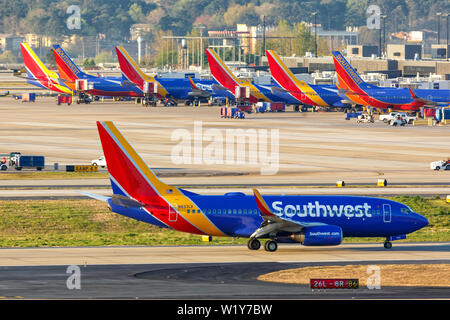 Atlanta, Georgia – April 3, 2019: Southwest Airlines Boeing 737-700 airplanes at Atlanta Airport (ATL) in the United States. - Stock Photo