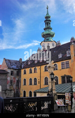 The Gothic tower of St Michaels Gate and Statue of St John on Michaels Bridge, Bratislava Old Town, Slovakia - Stock Photo