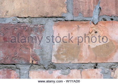 Background from a brick wall macro photo on a summer sunny day - Stock Photo