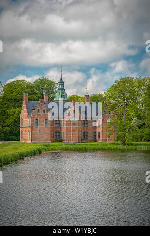 Frederiksborg is one of the most beautiful castles in Denmark situated at Hillerod. And the bath palace on the grounds is a little castle in itself. - Stock Photo