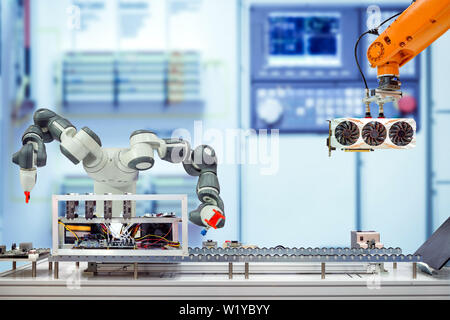 Industrial robotics automation working assemble computer bitcoin mining via conveyor belt on smart factory on blue tone blurred background - Stock Photo
