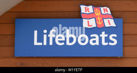 Sign for the Royal National Lifeboat Institute lifeboats - Stock Photo