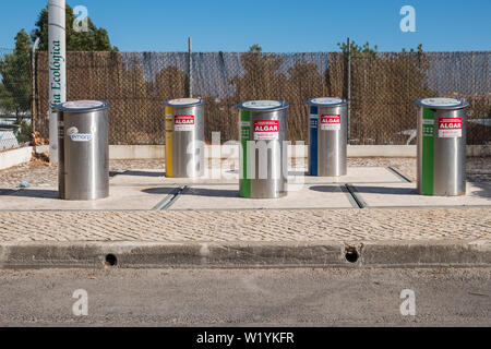 Pavement mounted recycling bins in Alvor, Algarve, Portugal - Stock Photo