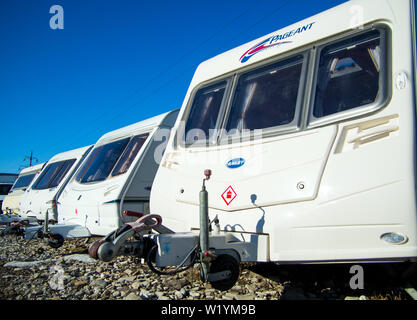 Voronezh, Russia - March 13, 2019: Motorhome trailers stand in a row in the parking lot - Stock Photo