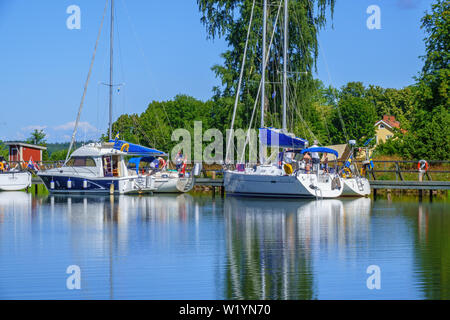 Pleasure boats lying on a bridge on a beautiful summer day at Gota canal in Sweden - Stock Photo