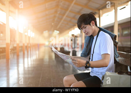 traveler reading a map on train station. - Stock Photo