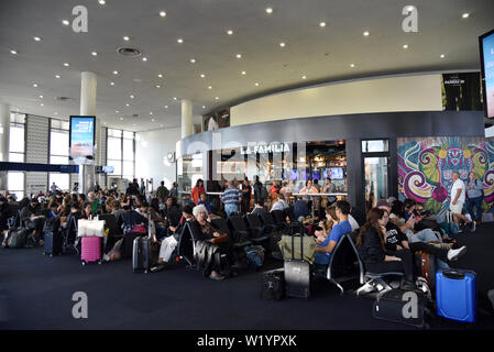 LOS ANGELES, CA, USA - JUNE 25, 2019: Travelers waiting for flights at LAX before a holiday weekend - Stock Photo