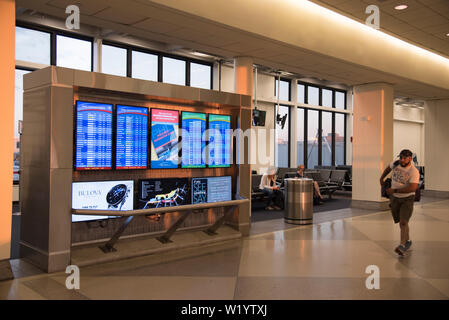 PHILADELPHIA, PENNSYLVANIA, USA - JUNE 26, 2019:  Arrivals and departures board at Philadelphia International Airport in early morning hours - Stock Photo