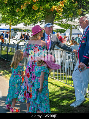Henley on Thames, Berkshire, UK. 4th July, 2019. Henley Royal Regatta. Former Olympian and Henley Royal Regatta's chairman, Sir Steve  Redgrave .talks to collegue and friends outside the Stewards Enclosure  . Credit Gary Blake/Alamy Live - Stock Photo