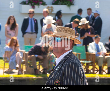 Henley on Thames, Berkshire, UK. 4th July, 2019. Henley Royal Regatta. Former Olympian and a  Henley Royal Regatta Umpire, Sir Matthew Pinsent ,standing in the umpires boat going past the spectators in the Stewards Enclosure to start the race. Credit Gary Blake/Alamy Live - Stock Photo