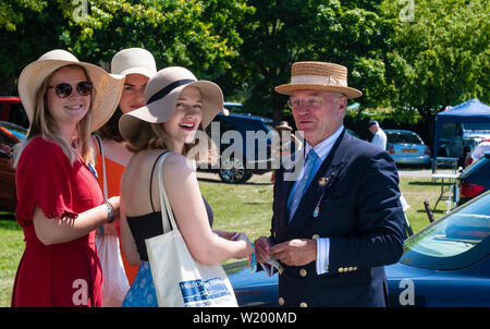 Henley on Thames, Berkshire, UK. 4th July, 2019. Henley Royal Regatta visitors talking with the coordinator of the Dutch Rowing Teams   in Lion Meadow car park . Credit Gary Blake/Alamy Live - Stock Photo