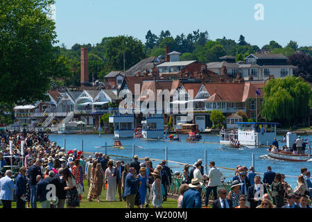 Henley on Thames, Berkshire, UK. 4th July, 2019. Henley Royal Regatta. Viewing the race from the Regatta  Enclosure with crowds in the Stewards Enclosure and Henley's  town behind, Credit Gary Blake/Alamy Live - Stock Photo