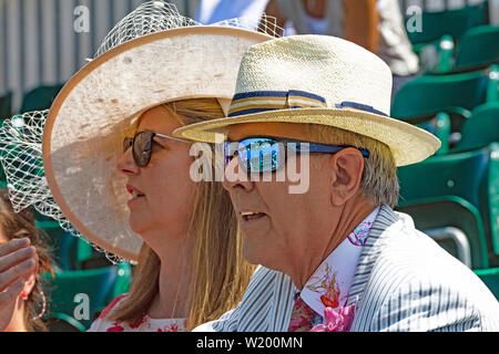 Henley on Thames, Berkshire, UK. 4th July, 2019. Henley Royal Regatta.Spectators viewing the race from the Regatta  Enclosure  with the current race reflecting in the mans sun glasses.  Credit Gary Blake/Alamy Live - Stock Photo
