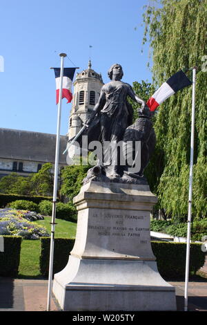 Franco-Prussian War Memorial Statue in front of St. Leopold Catholic Church in Normandy, France - Stock Photo