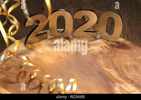 Happy New Year 2020. Symbol from number 2020 on wooden background - Stock Photo