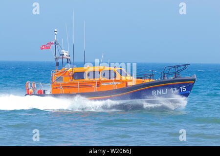 RNLI Scarborough Lifeboat crew demonstrating the Shannon Class all weather lifeboat during Scarborough Armed Forces Day 2019. - Stock Photo