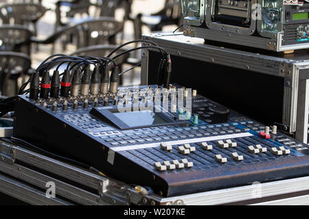 Santiago de Compostela, Spain; May 02, 2019: Music mixer on outdoors, mixing table with buttons and volume controls - Stock Photo