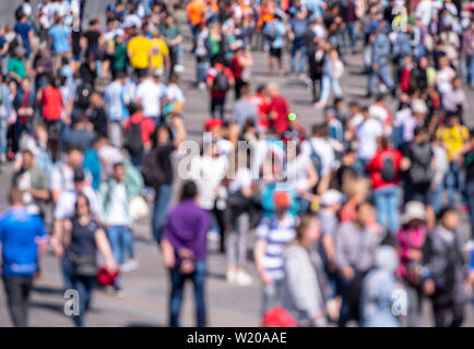Blurred Picture of crowd People as Background, out of focus Picture of Crowd of People in Summer Day - Stock Photo