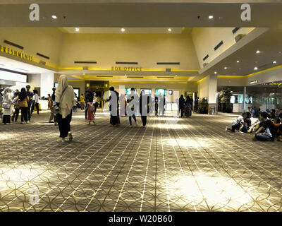 BEKASI, WEST JAVA, INDONESIA. July 5, 2019: Unrecognized people in XXI cinema inside a shopping mall. XXI Cinemas is the largest cinema chain in Indon - Stock Photo