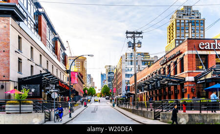 Yaletown, a historic industrial area of Vancouver in BC, Canada, where warehouses and factories have been converted to retail stores and condominiums - Stock Photo