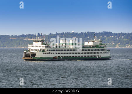 SEATTLE, WASHINGTON STATE, USA - JUNE 2018: Large car and passenger ferry crossing the bay from Seattle. - Stock Photo