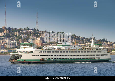 SEATTLE, WASHINGTON STATE, USA - JUNE 2018: Large car and passenger ferry crossing Puget Sound from Seattle. - Stock Photo