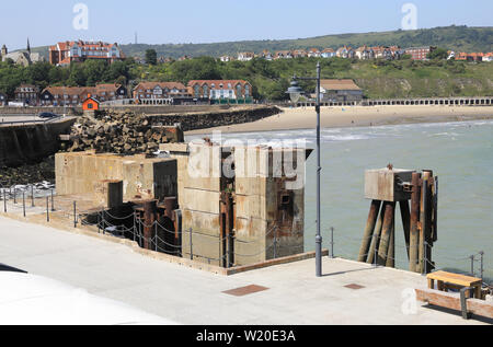 Concrete plinths or 'dolphins' on the Harbour Arm in Folkestone, previously used for roll-on-roll-off ferries, before they stopped running, in Kent UK - Stock Photo