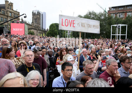 Manchester, UK, 4th July, 2019.Yoko Ono has invited the people of Manchester to gather and send a message of peace to the world.  A video featuring Yoko Ono played out to the crowds gathered in the gardens with hundreds of people taking part and ringing bells for peace.Cathedral Gardens, Manchester, UK. Credit: Barbara Cook/Alamy Live News - Stock Photo