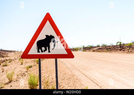 Warning road sign, warning drivers of the existence of elephants on the road. - Stock Photo