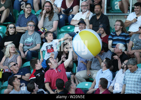 Cardiff, UK. 04th July, 2019. fans in the crowd play with a large beach ball. UEFA Europa league preliminary qualifying round match, 2nd leg, Cardiff Metropolitan University (Wales) v FC Progres Niederkorn (Luxembourg) at Cardiff International Sports campus Stadium in Cardiff, South Wales on Thursday 4th July 2019. Editorial Usage Only. pic by Andrew Orchard/Andrew Orchard sports photography/Alamy Live News Credit: Andrew Orchard sports photography/Alamy Live News - Stock Photo