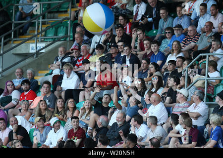 Cardiff, UK. 04th July, 2019. fans in the crowd play with a large beach ball.UEFA Europa league preliminary qualifying round match, 2nd leg, Cardiff Metropolitan University (Wales) v FC Progres Niederkorn (Luxembourg) at Cardiff International Sports campus Stadium in Cardiff, South Wales on Thursday 4th July 2019. Editorial Usage Only. pic by Andrew Orchard/Andrew Orchard sports photography/Alamy Live News Credit: Andrew Orchard sports photography/Alamy Live News - Stock Photo