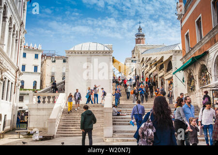 VENICE, ITALY - APRIL, 2018: Access to the famous Rialto Bridge over the Grand Canal in Venice built in 1591 - Stock Photo