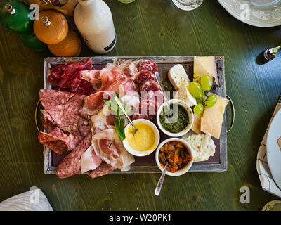 Cutting board based in charcuterie with jam variaties, antipasto, cheese and sauces - Stock Photo