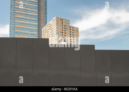 Tokyo Midtown tower seen behind a metal construction site wall  in Roppongi, Tokyo, Japan. Friday February 5th 2016 - Stock Photo