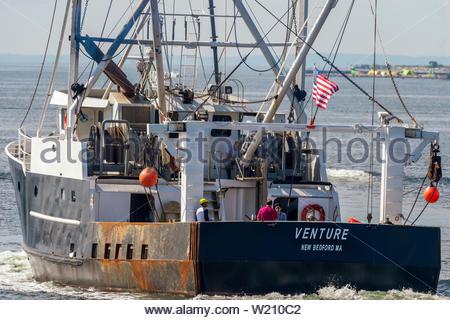 New Bedford, Massachusetts, USA - July 3, 2019: Scalloper Venture leaves New Bedford on summer morning - Stock Photo