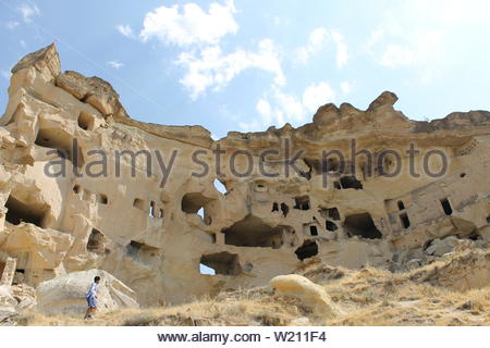 Structures built into pale rock are eroded by wind and other elements. - Stock Photo