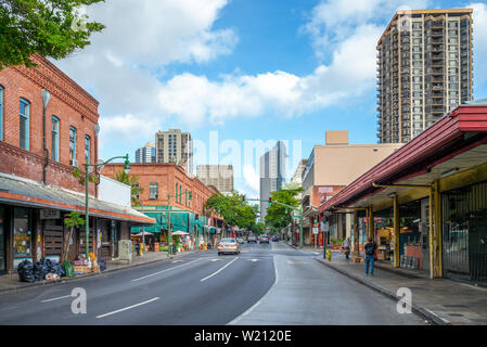 Honolulu, US - June 19, 2019: Street view of Chinatown in Hawaii. Laborers were imported from China to work on sugar plantations then moved to this ar - Stock Photo