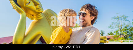 Happy tourists dad and son on background ofLying Buddha statue BANNER, LONG FORMAT - Stock Photo