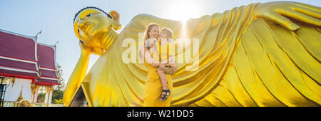 Happy tourists mother and son on background ofLying Buddha statue BANNER, LONG FORMAT - Stock Photo