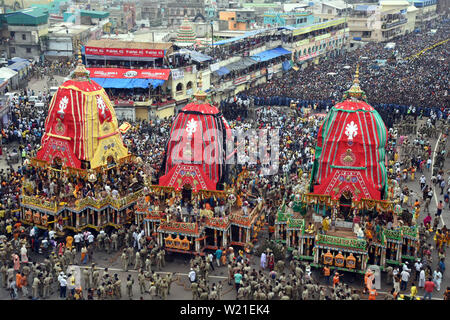 (190705) -- PURI, July 5, 2019 (Xinhua) -- Indian devotees participate in Rath Yatra festival (chariot journey of Jagannatha) in Puri, Orissa of India, July 4, 2019. The journey, one of the most important Hindu festivals of the year involves devotees pulling a chariot of Lord Jagannath, his brother Balabhadra and sister Subhadra. The festival is observed in different states of India during the month of June and July. (Str/Xinhua) - Stock Photo