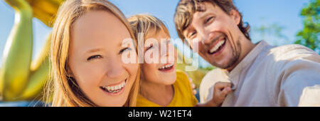 Happy tourists mother, father and son on background ofLying Buddha statue BANNER, LONG FORMAT - Stock Photo