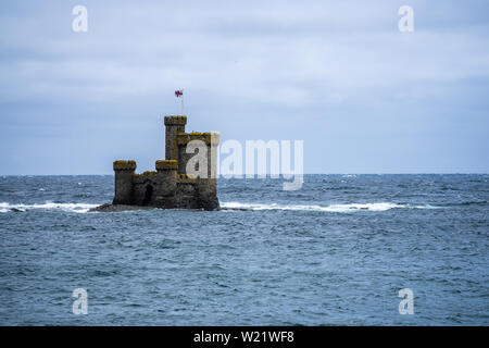 St Mary's Isle also known as Conister Rock or the Tower of Refuge is a partially submerged reef in Douglas Bay on the Isle of Man. - Stock Photo
