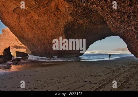 Red rock formation with arch on the beach, Plage Sidi Ifni, Morocco, Africa
