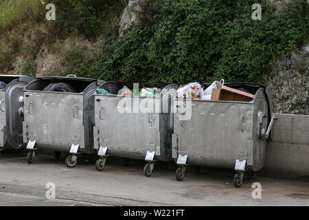 Containers for household garbage in the city. - Stock Photo