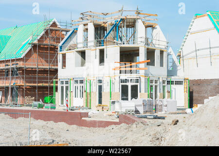 Houses under construction in Amsterdam region, The Netherlands. - Stock Photo