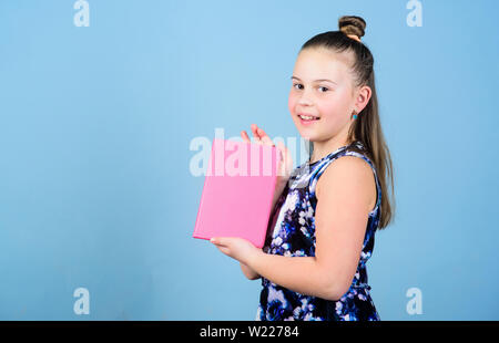Keeping secrets here. design expert. pr-specialist. small girl with pink note book. school child with notepad. workbooks for writing. school diaries for making notes. Keeping her secrets in diary. - Stock Photo