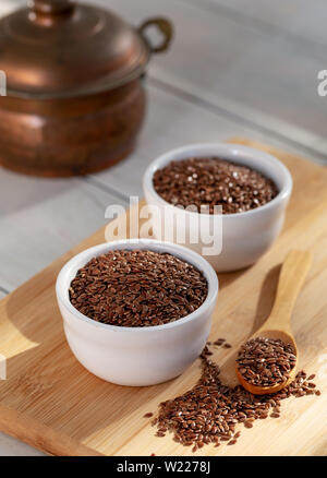 Siyez wheat bulgur in bowl and spoon on wooden background - Stock Photo