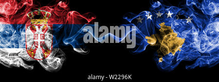 Serbia vs Kosovo, Serbia smoky mystic flags placed side by side. Thick colored silky smokes combination of Serbian and Kosovo, Serbia flag - Stock Photo